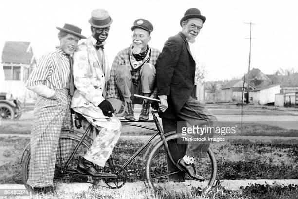 Vintage image of men as clowns on bike
