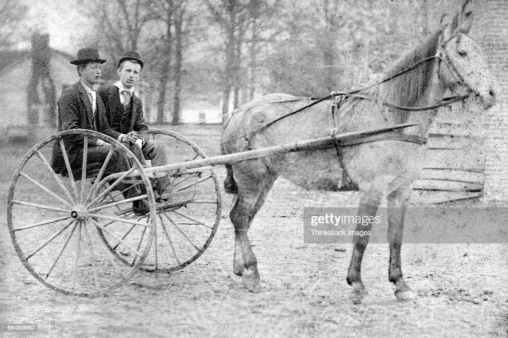 Vintage image of men in horse carriage : Stock Photo