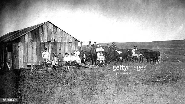 Vintage image of people and livestock on farm