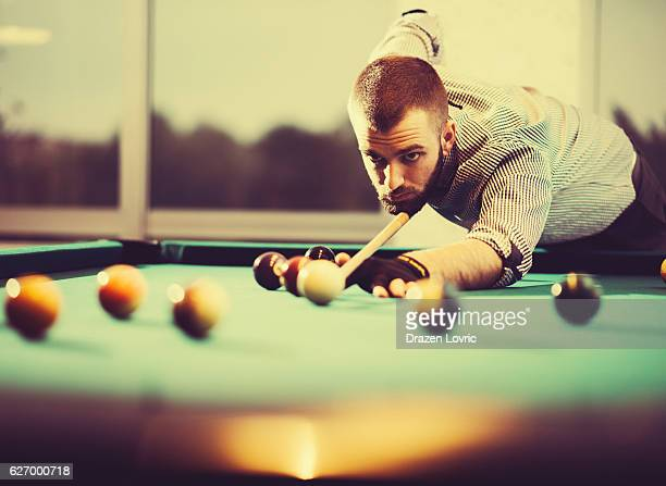 Vintage image of pool player in plaid shirt