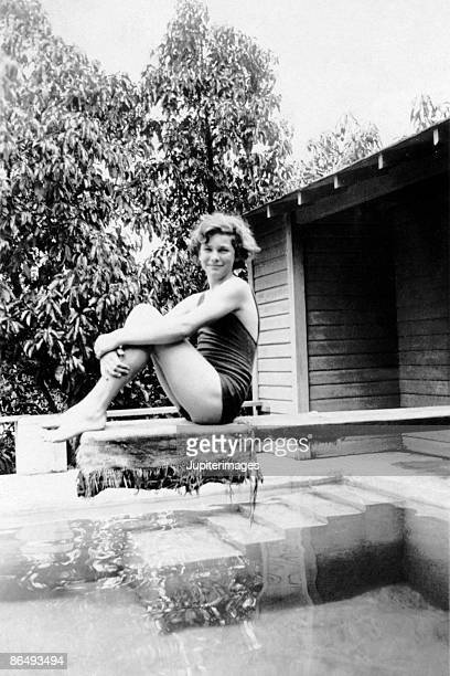 Vintage image of woman sitting on diving board