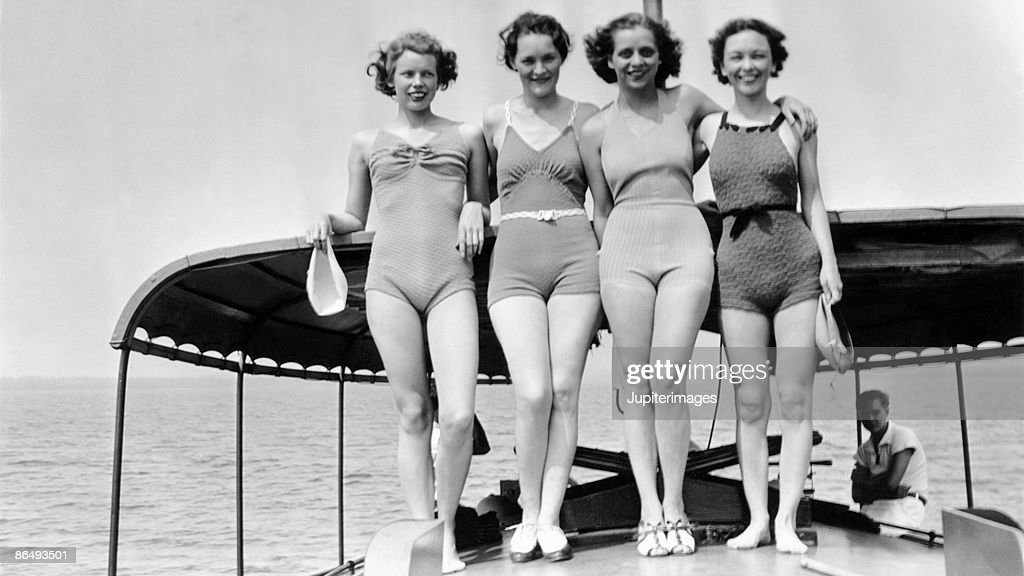 Vintage image of women in bathing suits standing on boat deck