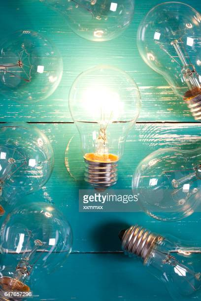 Vintage incandescent bulbs on turquoise wooden table