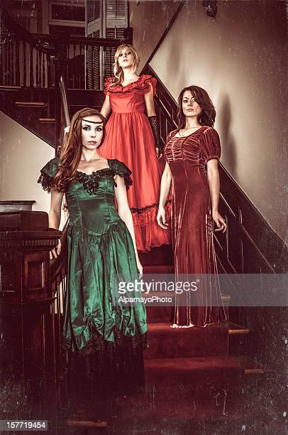 Vintage indoor portrait of young women on the stairs (II)