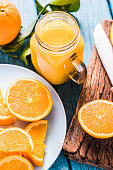 Vintage jar with fresh orange juice, healthy and clean eating