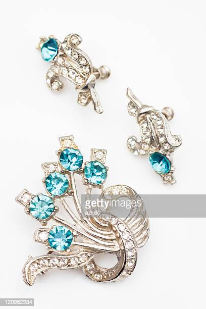 A vintage jewelry set with blue diamonds