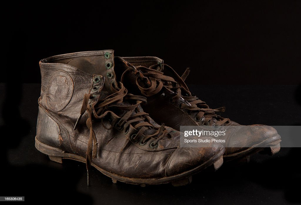 Vintage Leather Football Cleats. 1920's vintage leather football shoes with stacked cleats and high-top design.