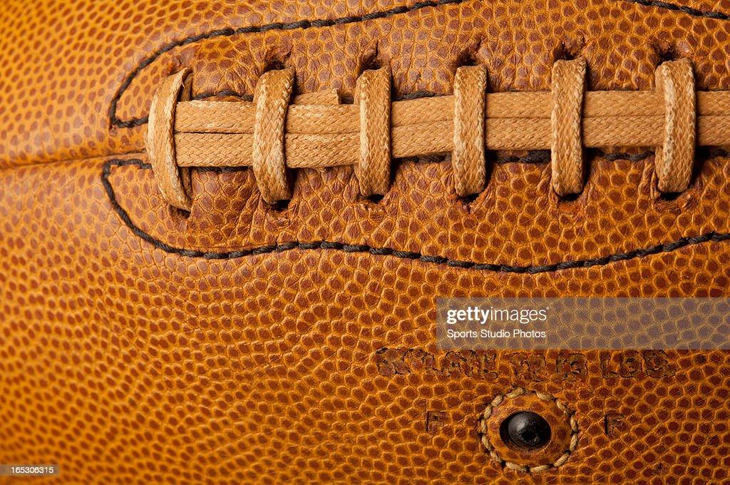 Vintage Leather Football. Closeup of vintage leather football lacings.
