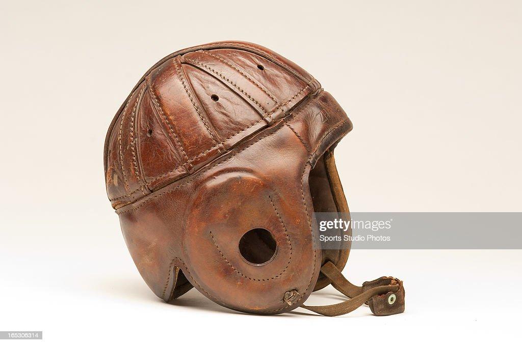 Vintage Leather Football Helmet. Vintage Spalding Sporting Goods leather football helmet with original chin strap.