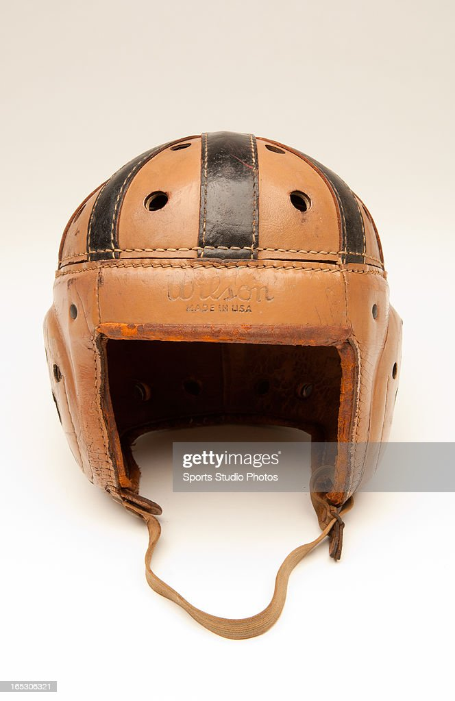 Vintage Leather Football Helmet. Vintage Wilson Sporting Goods two-toned leather football helmet with original chin strap.