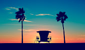Vintage Lifeguard Tower on Beach at sunset in San Diego, California