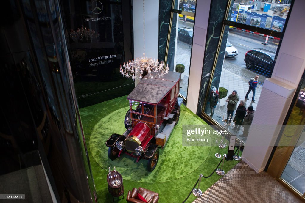 A vintage Mercedes-Benz automobile sits in a window display inside the Mercedes-Benz Gallery showroom in Berlin, Germany, on Thursday, Dec. 19, 2013. European new-car sales rose a third consecutive month in November, the longest period of gains in four years. Photographer: Krisztian Bocsi/Bloomberg via Getty Images