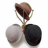 Vintage metal wall mounted hat stand with Derby, Bowler and Fedora Hats.