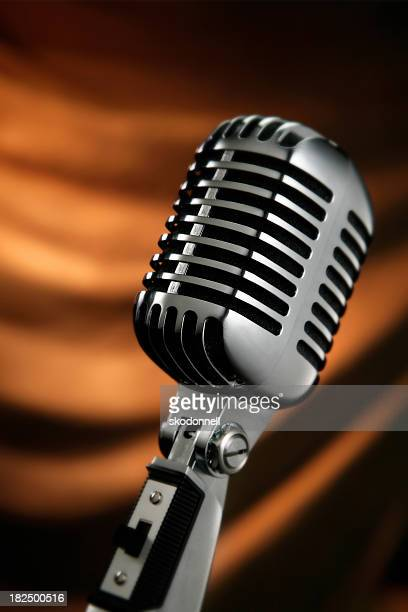 Vintage Microphone Against a Orange Curtain