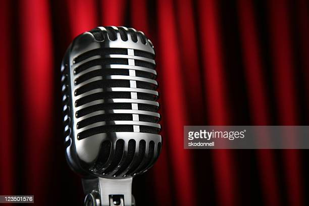 Vintage Microphone Against a Red Curtain