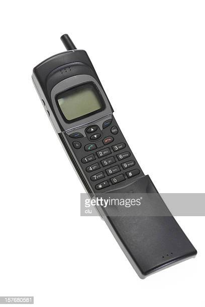 Vintage mobile phone on white background