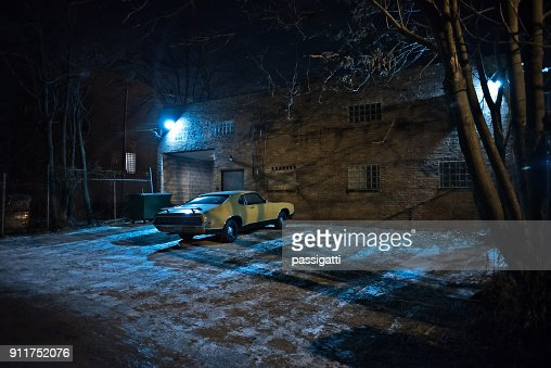Vintage Muscle Car In A Dark Chicago City Urban Alley On A Winter