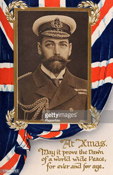 A vintage patriotic postcard with Christmas greetings featuring King George V and a wish for world peace during World War One circa 1915