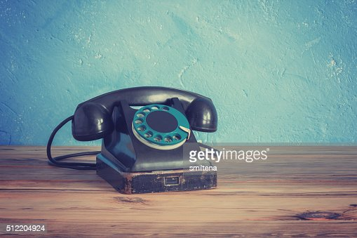 Vintage phone on a wooden table : Stock Photo