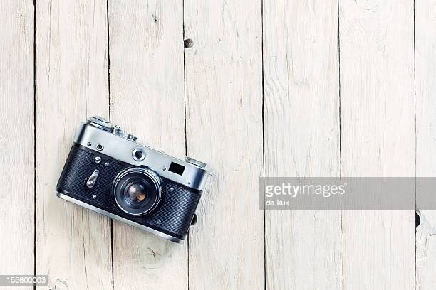Vintage photo camera on old wooden table