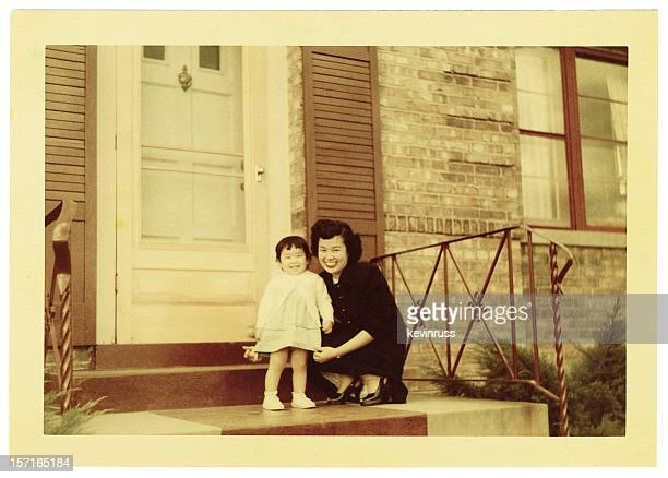 Vintage photo of Asian mother and toddler