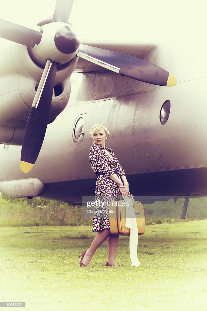 Vintage photo of beautiful girl and plane : Stock Photo