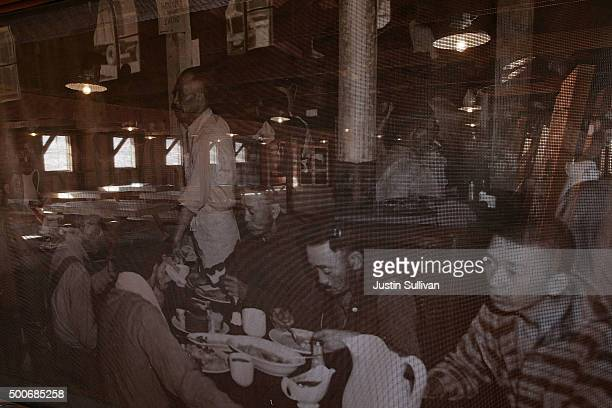 PA vintage photograph of Japanese men who were incarcerated at Manzanar War Relocation Center is displayed in a replica of a mess hall at Manzanar...