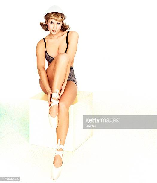 Vintage Pin-Up Girl Wearing Bathing Suit On A White Background