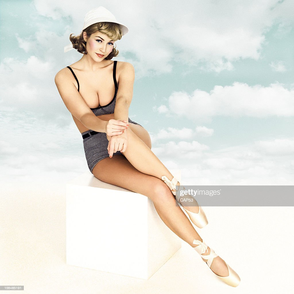 Beautiful Pin-Up Wearing Bathing Suit On A Cloudy Sky