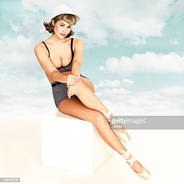 Vintage Pin-Up Wearing Bathing Suit On A Cloudy Sky Background