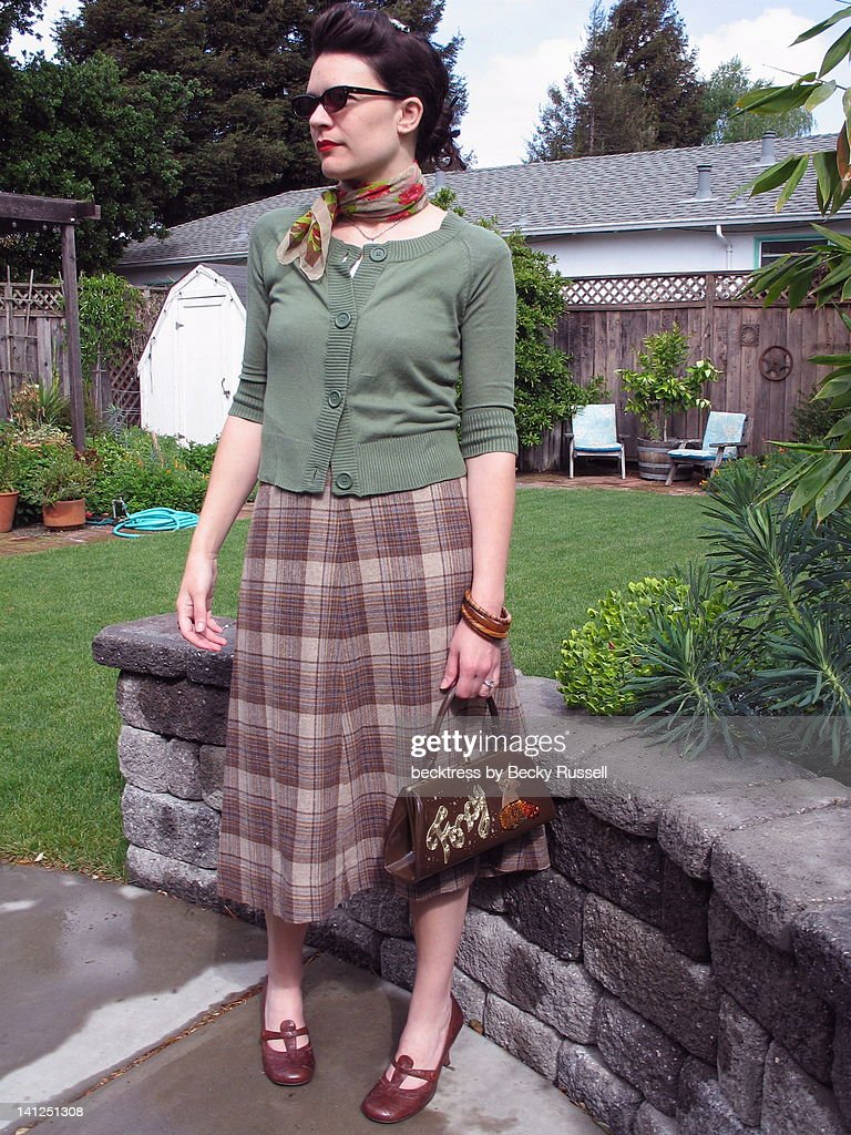 Vintage plaid skirt with green cardi : Stock Photo