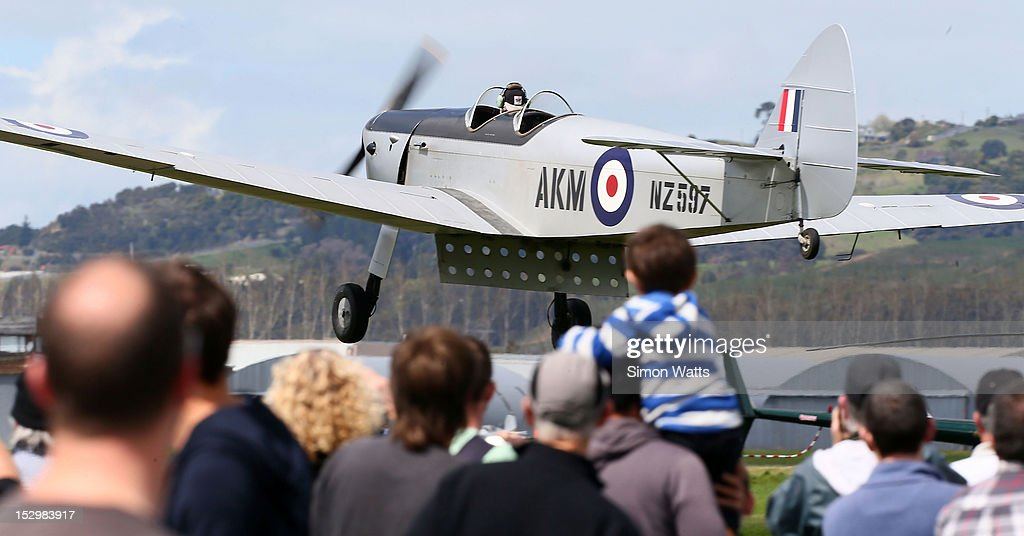 A vintage plane performs during an airshow commemorating the completion of the rebuild of de Havilland Mosquito KA 114, on September 29, 2012 in Ardmore, New Zealand. The plane was restored by Warbird Restorations at Ardmore Aerodrome and is the only flying Mosquito in the world.