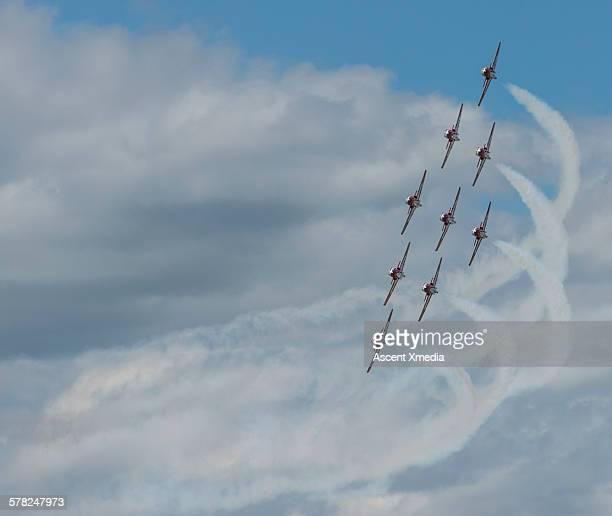 Vintage planes create pattern in big sky