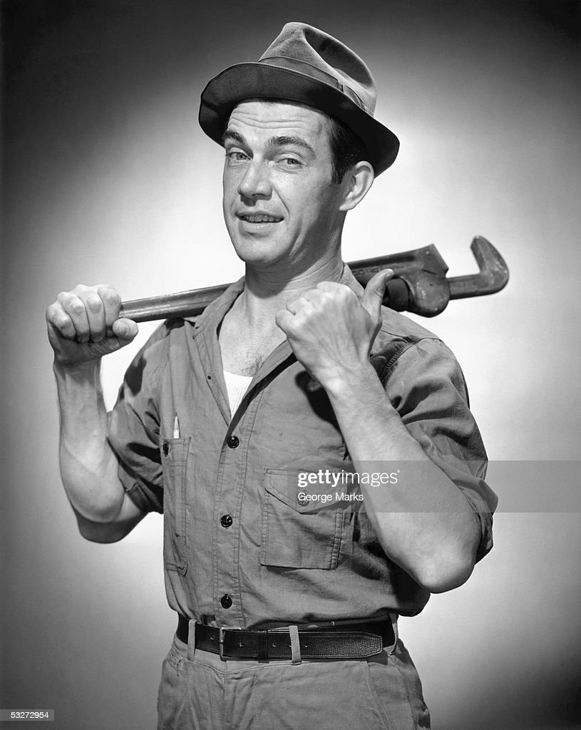 Vintage portrait of a mechanic : Stock Photo
