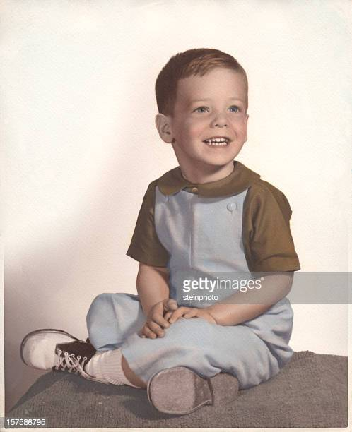 A vintage portrait of a young boy smiling
