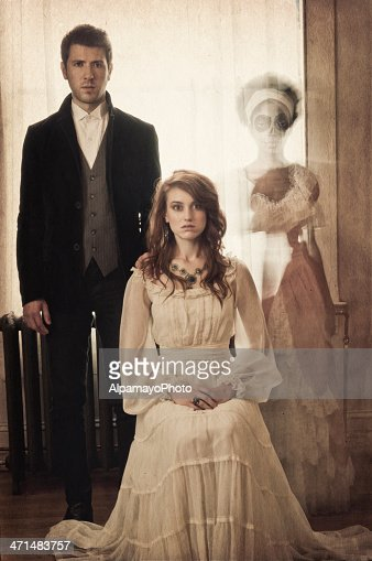 Vintage portrait of a young couple with ghostly apparation (II)