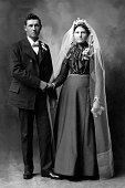 Vintage portrait of bride and groom holding hands