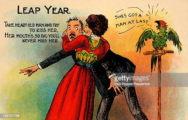 A vintage postcard celebrating Leap Year featuring a woman embracing a man with a parrot saying 'she's got a man at last' published circa 1910
