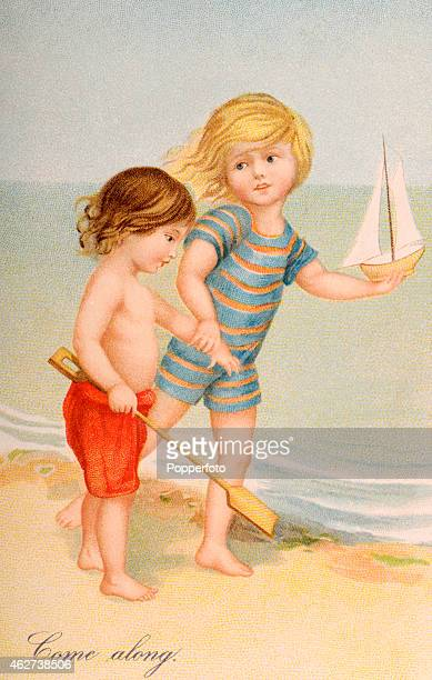 A vintage postcard illustration featuring two little children playing by the seaside one with a shovel and one with a toy sailboat circa 1900