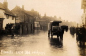 A vintage postcard picturing floods in Woking Surrey circa 1910