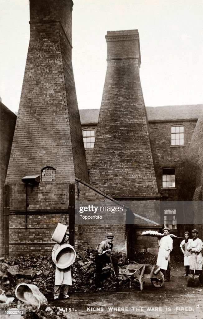 A vintage postcard showing pottery workers and the kilns where earthenware was fired near Stoke on Trent circa 1910