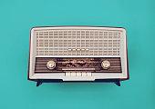 A sixties vintage tube radio on blue background