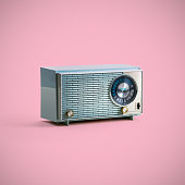 Blue vintage radio with clipping path from the 1950's shot on a pink background.