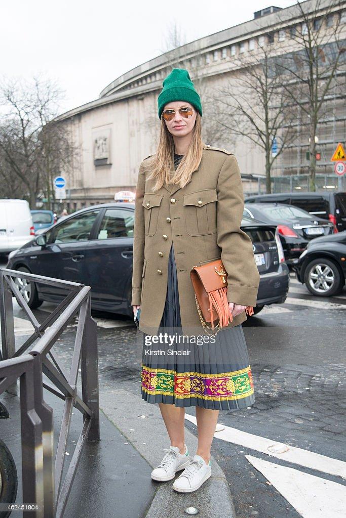Vintage researcher Racz Clara wears Adidas Trainers Ray Ban sunglasses Savas handbag and vintage coat on day 4 of Paris Haute Couture Fashion Week...