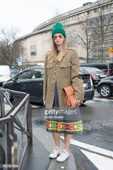 Vintage researcher Racz Clara wears Adidas Trainers Ray Ban sunglasses Savas handbag and vintage coat on day 4 of Paris Haute Couture Fashion Week...