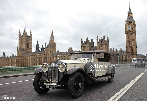 Vintage Rolls Royce cars drive past the Houses of Parliament during a centenary parade on February 6 2011 in London England Rolls Royce is...