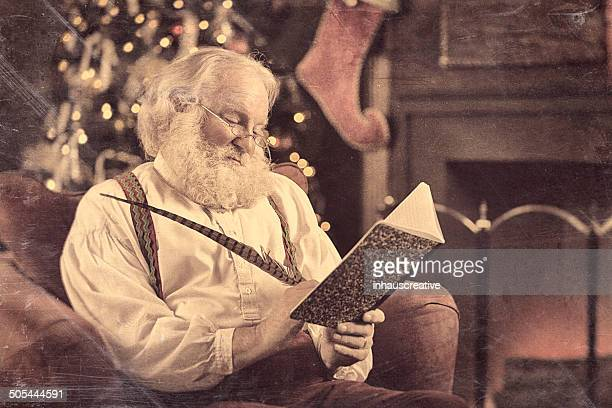 Vintage Santa Claus writing in his journal