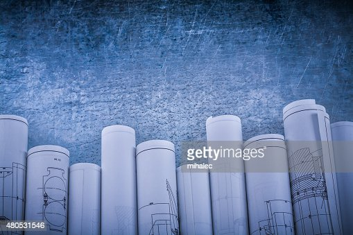 Vintage scratched shiny silver-metal background with rolled blue : Stock Photo
