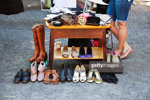 Vintage shoes and table at a flea market.
