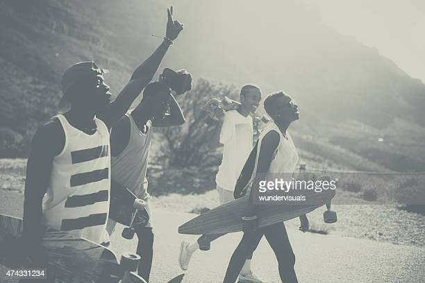 Vintage shot of cool teen skateboarders walking together